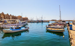 Old port of Chania town with parked yachts and fishing boats Royalty Free Stock Image