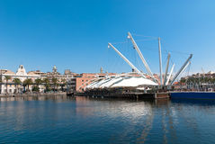 Old port Genoa, Italy. Old Port of Genoa,with the Bigo, reconstruction of large cranes mounted on ships. An experiment in design created as a backdrop of the Royalty Free Stock Photos