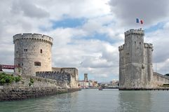 The old port of La Rochelle (France) seen from the ocean. La Rochelle, entrance of the harbour with La Chaîne and St Nicolas (right) towers Stock Images