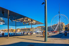 Old Port with mirror - shed and Ferris wheel Stock Photos