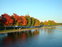 Old Port of Montreal, Canada. Autumnal trees, pond and construction in the Old Port royalty free stock image