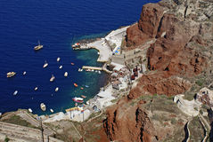 Old port of Oia village at Santorini island in aegean sea, Greec Stock Photos