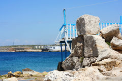 Old port on the Rocks with the sea Royalty Free Stock Photo