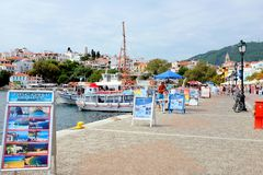 Old Port, Skiathos, Greece. Skiathos, Greece. September 09, 2017.  The quayside with boat owners selling pleasure trips to other locations and holiadymakers Royalty Free Stock Photography