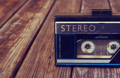 Old portable cassette player on a wooden background. image is instagram style filtered Stock Images