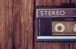Old portable cassette player on a wooden background. image is instagram style filtered Stock Image