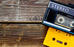 Old portable cassette player on a wooden background. image is instagram style filtered. Royalty Free Stock Image