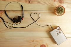Free Old Portable Cassette Tape Player And Headphones On Wooden Royalty Free Stock Photography - 128437967