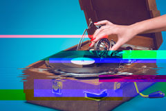 Old portable gramophone with female hand and glitch effect Royalty Free Stock Photography