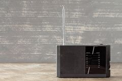 Old portable radio receiver. Device on wooden background Stock Images