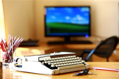 Old portable typewriter. An old portable typewriter on a wooden table in an office Royalty Free Stock Photos