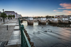 Old Portuguese town of Tavira. River view at the Roman bridge. Stock Photography
