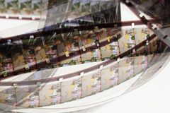 Old positive 16 mm film strip on white background Stock Photos
