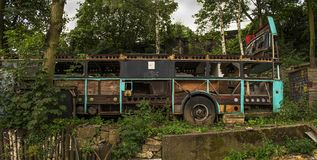 Old, post Apocalyptic looking decayed and rotting. Bus in the woods Cologne. Germany Royalty Free Stock Image