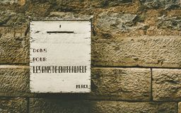 Old post box on a wall. In france Stock Images