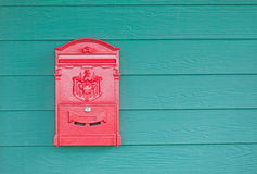 The old post box. Yellow color on the wall design Royalty Free Stock Image