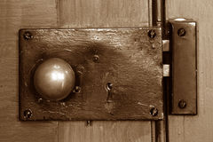 Old post office door knob. Antique post office door knob still in use in an old town in Illinois Royalty Free Stock Photography
