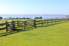 Old post and rail fence with gates Royalty Free Stock Photo