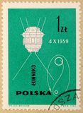 Old post stamp of Poland, dedicated to space exploration and first satellites. KHARKIV, UKRAINE - MARCH 5, 2018: Old post stamp of Poland, dedicated to space royalty free stock photos