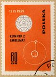 Old post stamp of Poland, dedicated to space exploration and first satellites. KHARKIV, UKRAINE - MARCH 5, 2018: Old post stamp of Poland, dedicated to space stock photography