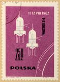Old post stamp of Poland, dedicated to space exploration and first satellites. KHARKIV, UKRAINE - MARCH 5, 2018: Old post stamp of Poland, dedicated to space stock photo