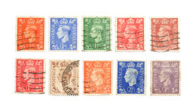 Old postage stamps. Old british postage stamps on white background Stock Photography