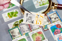 Old postage stamps in album. Close-up stock image