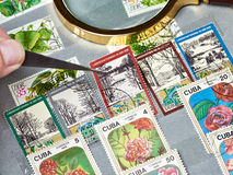 Old postage stamps in album Stock Photos