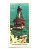 Old postage stamps from USA with Lighthouse. Vintage Royalty Free Stock Photography