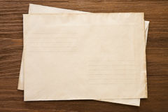 Old postal envelope on wood Stock Photography