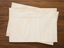 Old postal envelope on wood Stock Photo