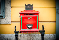 Old postbox in street of Budapest. Royalty Free Stock Image