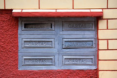 Old postboxes on wall in Brazil Stock Images