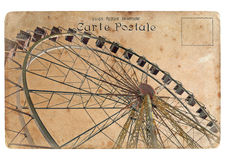 An old postcard with a big Ferris wheel. Retro styling Royalty Free Stock Image