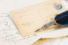 Old postcard with feather pen Royalty Free Stock Photo