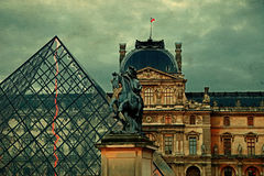 Old postcard with the Louvre Museum. Paris, France - October 13, 2015: Old postcard with the Louvre Museum of Paris, France.Vintage processing Stock Photos