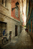 Old postcard with one small street in Trieste, Italy 1 Royalty Free Stock Photography