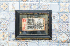 Old postcard of paris in a frame on the wall in a cafe.  Stock Photo
