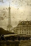 Old postcard with vintage cannons and Eiffel tower Stock Photo