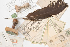Old postcards with stamp and feather Royalty Free Stock Photography