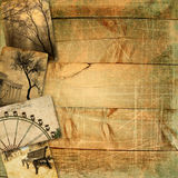 Old postcards on wooden planks with scratches and texture Royalty Free Stock Images