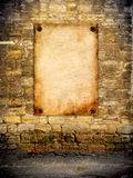 The old poster attached to the coquina wall Royalty Free Stock Photography