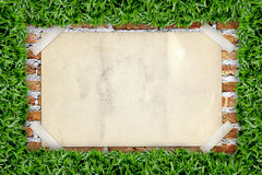 Old poster in grass frame Royalty Free Stock Photo