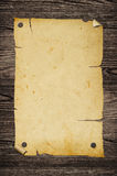 Old poster on wooden wall. Royalty Free Stock Photos