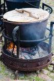Old pot for cooking over a campfire. Close-up Stock Images