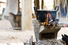 Old pot and craft for steam cooking on stove Stock Image