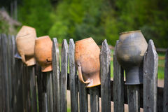 Old pot on the fence Royalty Free Stock Image