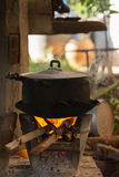 Old pot standing on wood burning stove Royalty Free Stock Photos
