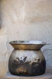 Old pot, white walls, concrete floors, old, black. Stock Photo