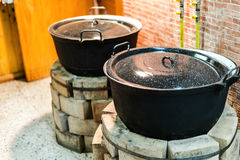 Old pots on brick ovens barely used Royalty Free Stock Photo